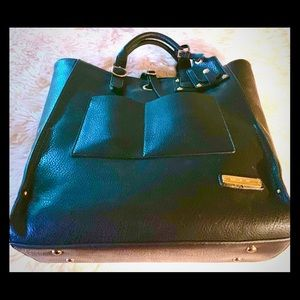 Adrienne Vittadini Black Grommet collection tote.